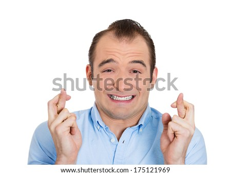 Closeup portrait of young funny guy, business man crossing fingers, wishing, hoping for the best, miracle isolated on white background. Positive human emotions, facial expressions, feelings attitude - stock photo