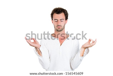 Closeup portrait of young handsome male, in meditation pose, relaxing, in zen, isolated on white background enjoying silence and tranquility. Stress reducing techniques.  - stock photo