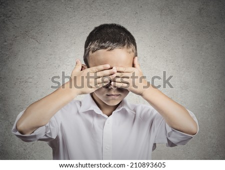 Closeup portrait of young handsome man closing, covering eyes with hands can't see, hiding, isolated grey wall background. See no evil concept. Human emotions, facial expressions, feelings, reaction - stock photo