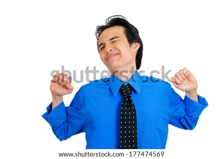 Closeup portrait of young handsome tired spent fatigued man stretching extending flexible arms, back, shoulders, neck, isolated on white background. Positive emotion facial expression feeling - stock photo