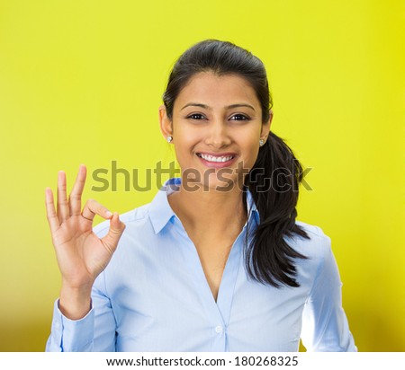 Closeup portrait of young happy, smiling excited beautiful natural woman giving OK sign with fingers, isolated on green background. Positive human emotion facial expressions symbols, feelings attitude - stock photo