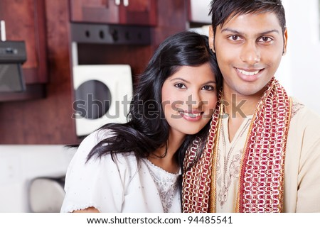 closeup portrait of young indian couple hugging - stock photo