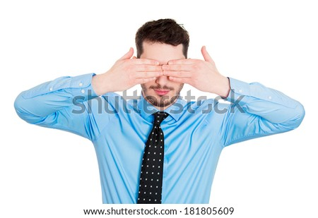 Closeup portrait of young male handsome man closing covering eyes with hands can't see and hiding, isolated on white background. See no evil concept. Negative Human emotions facial expression feelings - stock photo