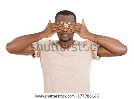 Closeup portrait of young male, shy man closing covering eyes with hands can't see, hiding, isolated on white background. See no evil concept. Negative human emotion facial expression feeling reaction