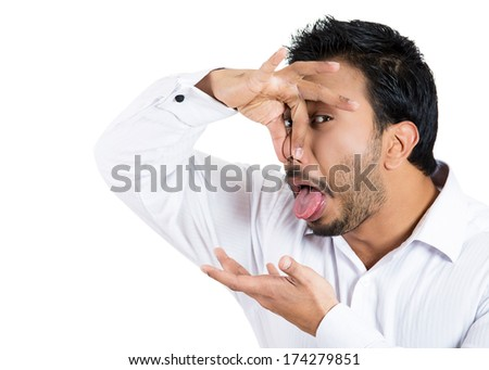 Closeup portrait of young man, disgust on his face, pinches his nose looks at you, something stinks, very bad smell, situation, isolated on white background. Negative emotion facial expression feeling - stock photo