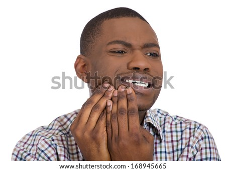 Closeup portrait of young man in shirt with tooth ache crown problem about to cry from pain touching outside mouth with hand, isolated white background. Negative emotion facial expression feeling - stock photo