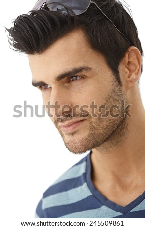 Closeup portrait of young man, looking away. Side view. - stock photo