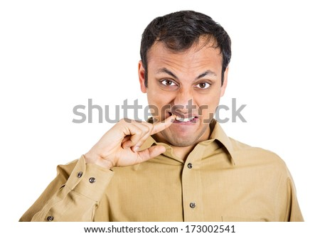Closeup portrait of young man picking up in his mouth with hand, finger, feeling awkward about situation he got into, isolated on white background. Negative human emotion, facial expressions, attitude - stock photo