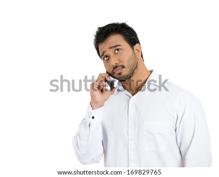 Closeup portrait of young man, student, agent, corporate employee, deal maker, sales person talking on a phone, isolated on white background. Business communication, success. Human face expressions - stock photo