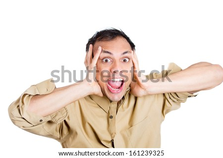Closeup portrait of young man, worker holding hands to ears covering to shut out noise, looking stressed and pushed to limit, isolated on white background . Negative Human emotion facial expressions  - stock photo
