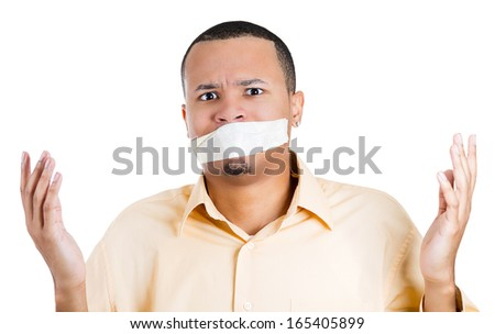 Closeup portrait of young moral afraid male adult man covering closed mouth, eyes open. Speak no evil concept, isolated on white background. Human emotion facial expression sign, symbol, feelings