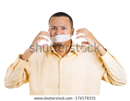 Closeup portrait of young moral afraid male adult man covering closed taped mouth, eyes open. Speak no evil concept, isolated white background. Negative emotion facial expression sign, symbol, feeling - stock photo