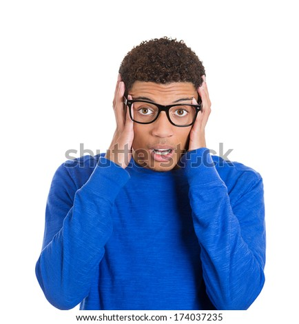 Closeup portrait of young nerd man with big glasses balking at some awkward situation he observed embarrassed for someone else, isolated on white background. Negative emotion facial expression feeling - stock photo