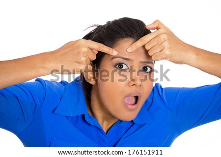 Closeup portrait of young pretty beautiful frustrated woman surprised stunned to see zit on her face, isolated on white background. Negative emotion facial expression feelings, situation, reaction - stock photo