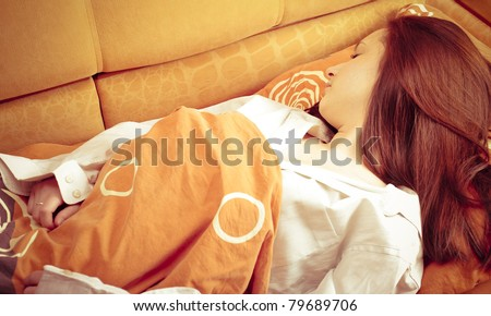 Closeup portrait of young pretty girl laying on her bed at her modern stylish apartment. Sleeping - stock photo