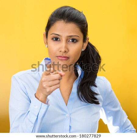 Closeup portrait of young pretty unhappy, serious woman pointing at someone as if to say you did something wrong, bad mistake isolated on yellow background. Negative emotion, facial expression feeling - stock photo