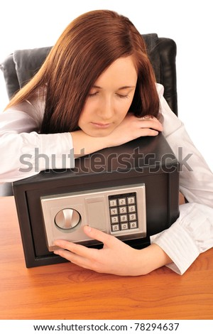 Closeup portrait of young pretty woman at her desk with deposit safe - stock photo