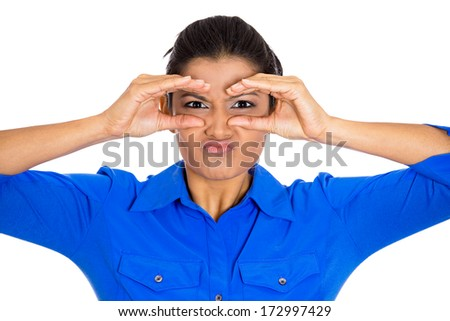 Closeup portrait of young pretty woman, peeking through her fingers like binoculars, looking angry at what she searches for in the distance or future, isolated on a white background. Negative emotion - stock photo
