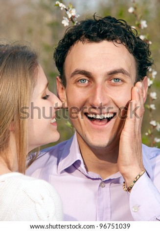 Closeup portrait of young romantic couple outdoors in spring