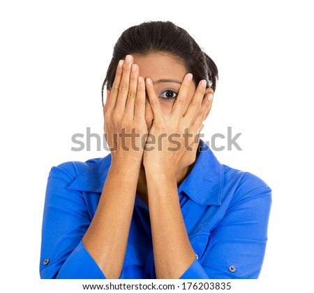 Closeup portrait of young scared terrified horrified shocked woman peeking through covered hand, can't believe what she sees, isolated on white background. Negative emotion facial expression feelings. - stock photo
