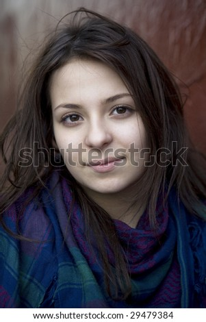 closeup portrait of young serious teen girl  in scarf