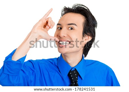 Closeup portrait of young silly goofy man gesturing with hands thumb to go out party and get drunk, hammered, wasted, tipsy, isolated on white background. Positive emotion facial expression feeling - stock photo