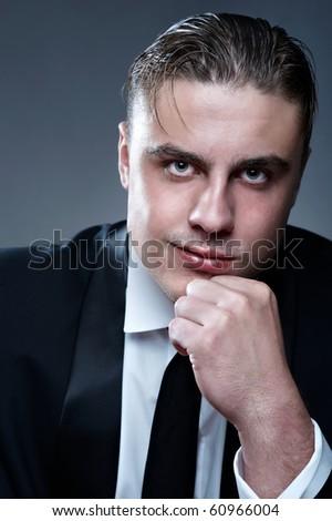 Closeup portrait of young smiling businessman - stock photo