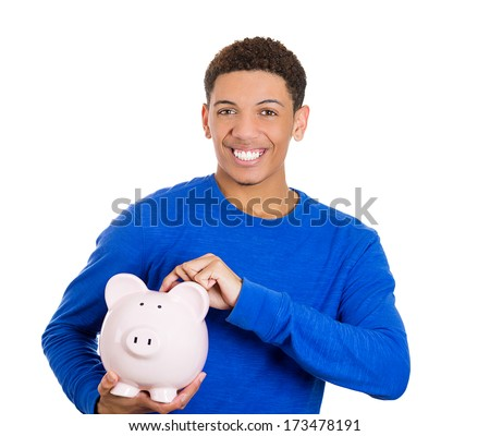 Closeup portrait of young smiling school student, worker man holding piggy bank, isolated on white background. Smart currency financial investment wealth decisions. Budget management and savings - stock photo