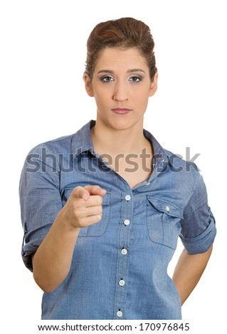 Closeup portrait of young unhappy, serious woman pointing at someone as if to say you did something wrong, bad boy, isolated on white background. Negative human emotions, facial expressions, feelings - stock photo