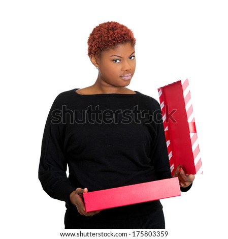 Closeup portrait of young upset bothered woman receiving gift very displeased with what she received, isolated on white background. Negative emotion facial expression feeling, attitude