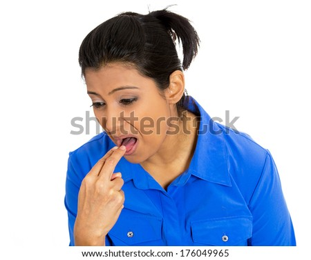 Closeup portrait of young woman, annoyed, frustrated fed up sticking fingers in her throat showing she is about to throw up. Case anorexia nervosa, Isolated on a white background. Negative emotion - stock photo