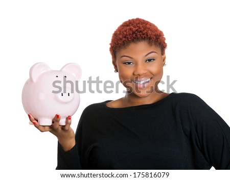 Closeup portrait of young woman holding her piggy bank friend in hand, isolate on white background. Positive emotion facial expression feelings. Smart wise saving paid financial decisions. Nest egg - stock photo