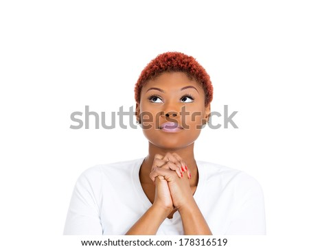 Closeup portrait of young woman praying, eyes opened, looking up, hoping for best, asking for forgiveness, miracle isolated on white background. Positive human emotions, facial expression feelings - stock photo