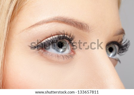 closeup portrait of young woman's eye zone make up - stock photo