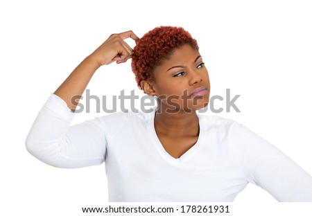 Closeup portrait of young woman scratching head, thinking, daydreaming deeply about something, looking sideways, isolated on white background. Human facial expression, emotion, feeling, signs, symbols - stock photo