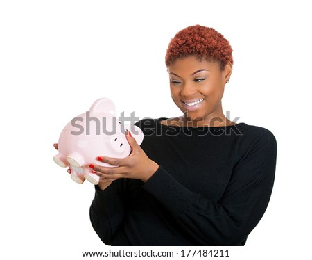 Closeup portrait of young woman, student holding her piggy bank friend in hand, isolate on white background. Positive emotion facial expression feeling. Smart wise saving, financial decision. Nest egg - stock photo