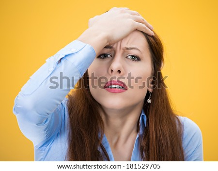 Closeup portrait of young woman, unhappy student, female worker, hand on forehead very upset sad disappointed depressed lost isolated on yellow background. Human emotions, facial expressions, reaction - stock photo