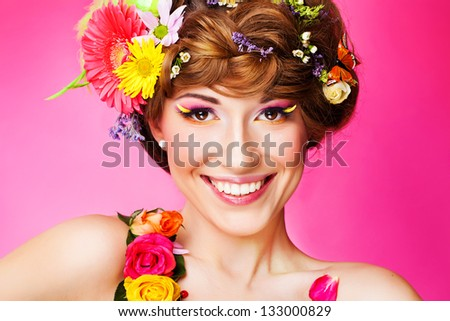 Closeup portrait of young woman with bright glamour makeup - stock photo
