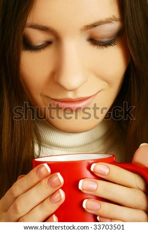 closeup portrait of young woman with mug - stock photo