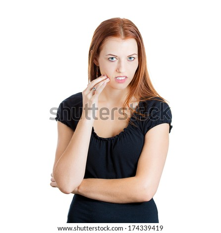 Closeup portrait of young woman with sensitive tooth ache crown problem about to cry from pain touching outside mouth with hand, isolated white background. Negative emotion facial expression feeling