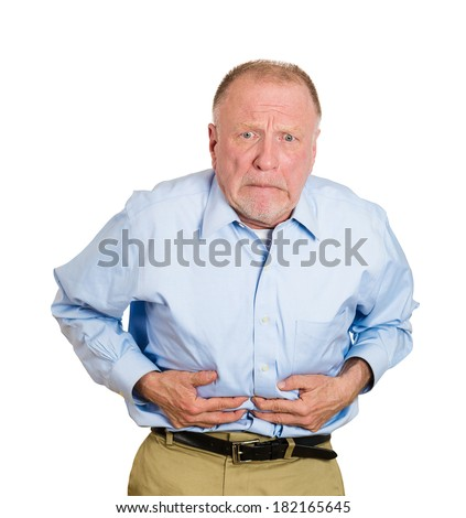 Closeup portrait old business man, elderly executive, boss, corporate worker, retired guy, unhealthy grandfather doubling over in stomach pain, isolated white background. Human emotions. Acute abdomen - stock photo
