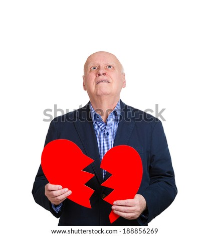 Closeup portrait, old man, senior executive, business man, corporate employee, mature guy, holding broken heart in his hands, about to cry, isolated white background. Human emotions, expressions - stock photo