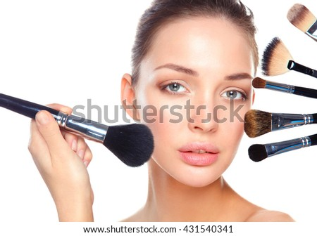 Closeup portrait picture of beautiful woman with brushes - stock photo