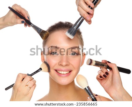Closeup portrait picture of beautiful woman with brushes, isolated