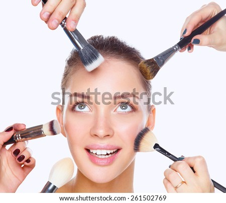 Closeup portrait picture of beautiful woman with brushes, isolated - stock photo