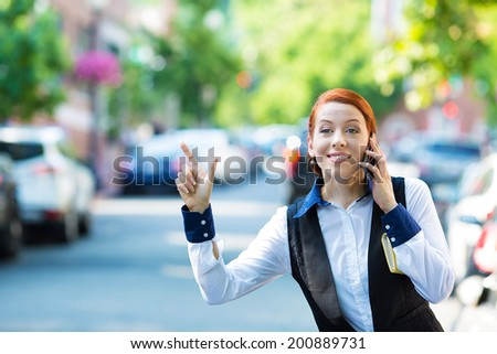 Closeup portrait pretty, young business woman talking on smart phone, hails taxi cab in city Washington DC isolated street background. Positive human emotions, facial expressions, life journey concept - stock photo