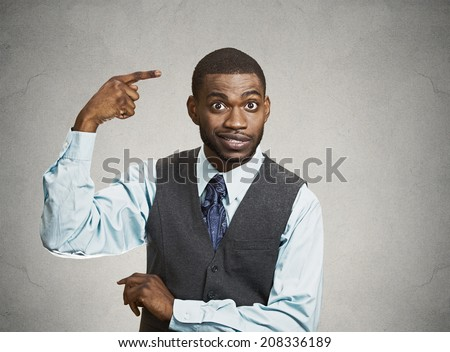 Closeup portrait rude difficult angry young executive businessman gesturing with finger against temple are you crazy? Isolated grey color background. Negative human emotion facial expression feeling - stock photo