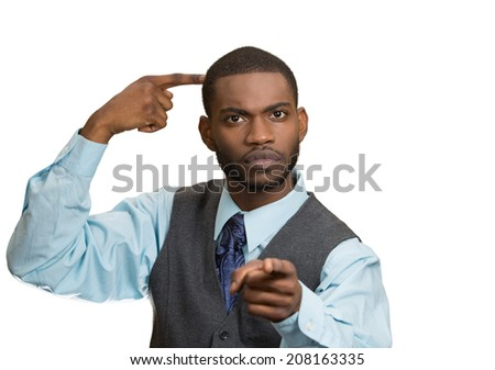 Closeup portrait rude, difficult, angry young executive businessman gesturing with fingers against temple, are you crazy? Isolated white background. Negative human emotion, facial expression, feelings - stock photo