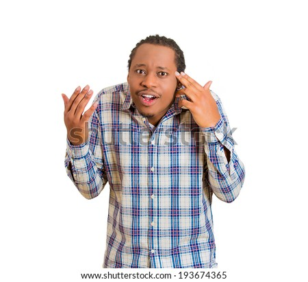 Closeup portrait rude, difficult, angry young man gesturing with fingers against his temple, are you crazy? Isolated white background. Negative human emotions, facial expressions, feelings, reaction - stock photo