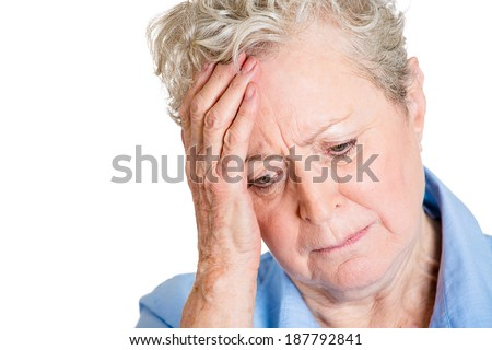 Closeup portrait, sad, alone, dark, gloomy, frustrated stressed senior mature woman, hand on head, having really bad nightmare day. Negative emotion facial expression feelings. - stock photo